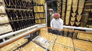 Merchants wear face masks against the coronavirus at a jewellery shop at the Dubai Gold Souk
