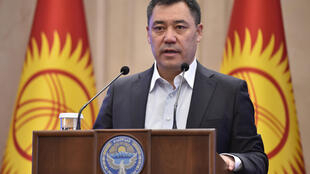Kyrgyzstan's recently-appointed Prime Minister Sadyr Japarov addresses the Kyrgyz Parliament in Bishkek on Friday as part of efforts to end a political crisis over a disputed October vote