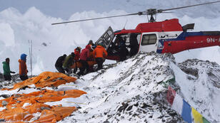 Roberto Schmidt, AFP I A rescue helicopter takes off with the injured from Everest Base Camp on April 26, 2015