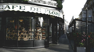 A picture taken on March 15, 2020, in the Saint-Germain-des-Près district of Paris shows chairs piled up inside the Café de Flore after cafés and restaurants were ordered to close as of midnight Saturday.