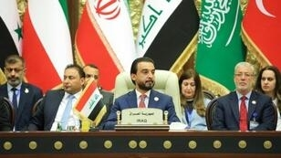 A handout picture released by the Iraqi parliament's press office on April 20, 2019 shows Speaker Mohammed al-Halbusi presiding over a conference with peers from neighbouring countries' legislatures