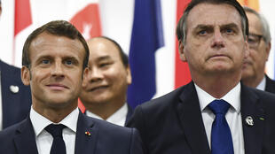 France's President Emmanuel Macron and Brazil's President Jair Bolsonaro attend an event on women's empowerment during the G20 Summit in Osaka, on June 29, 2019.
