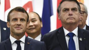 El presidente de Francia, Emmanuel Macron, y el presidente de Brasil, Jair Bolsonaro, asisten a un evento sobre el empoderamiento de las mujeres durante la Cumbre del G20 en Osaka, el 29 de junio de 2019.