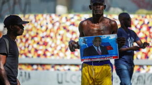 A man holds a photograph of Supreme Court Judge Joseph Mecene Jean-Louis during protests against Haiti's President Jovenel Moise, in Port-au-Prince, Haiti February 8, 2021.