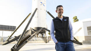 Billionaire Jared Isaacman, who will command the first all-civilian mission into Earth's orbit, stands in front of a Falcon 9 rocket at SpaceX in Hawthorne, California