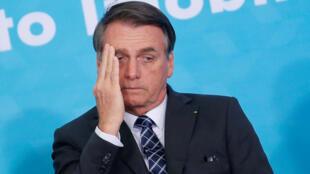 El presidente brasileño, Jair Bolsonaro, gesticula en un acto en el palacio Planalto de Brasilia.