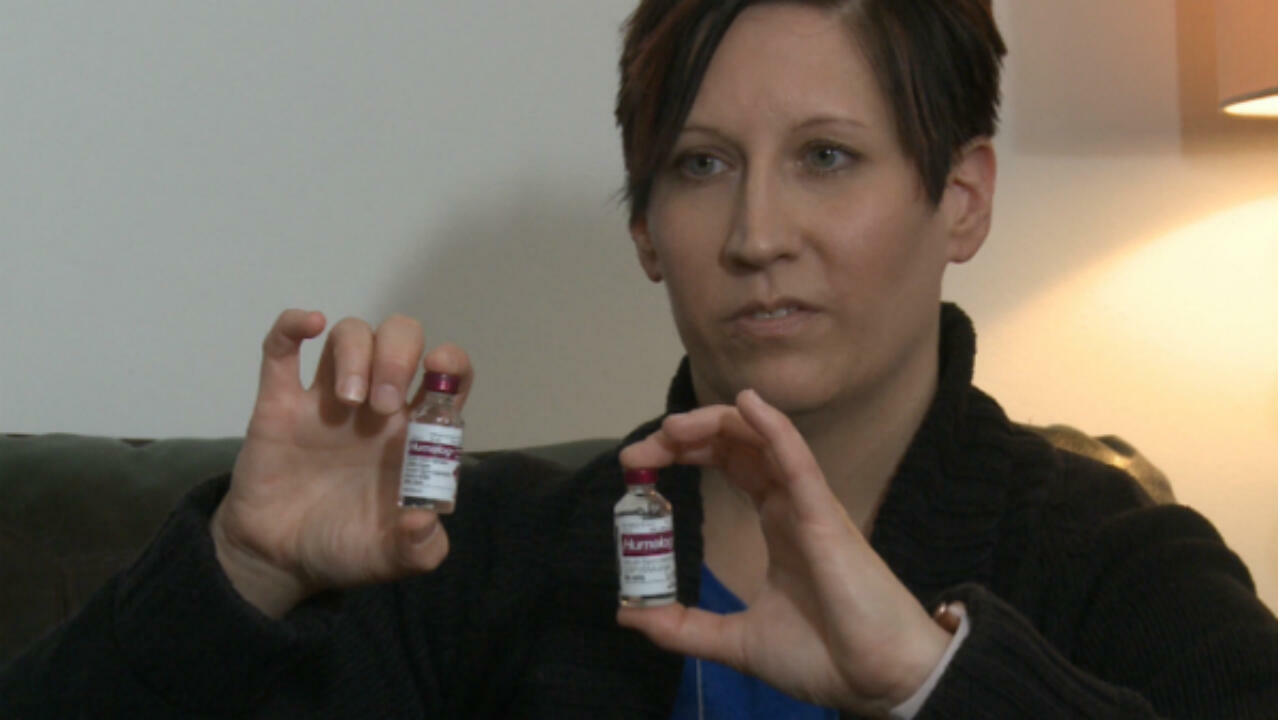 Angela Lautner shows two vials of Humalog insulin, one bought in Canada, the other in the US.