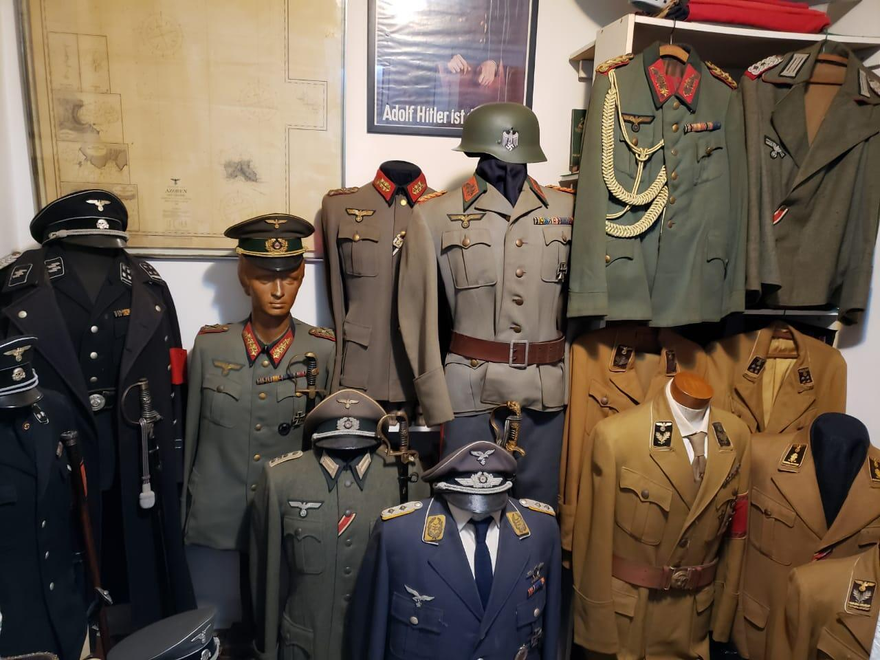Handout picture released on October 6, 2021 by Rio de Janeiro Civil Police showing Nazi  uniforms found inside the house of a man suspected of molesting a 12-year-old boy in the Vargem Grande neighbourhood, Rio de Janeiro, Brazil.