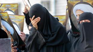 نساء يتظاهرن في السعودية بعد إعدام رجل الدين الشيعي نمر النمر، 2016
