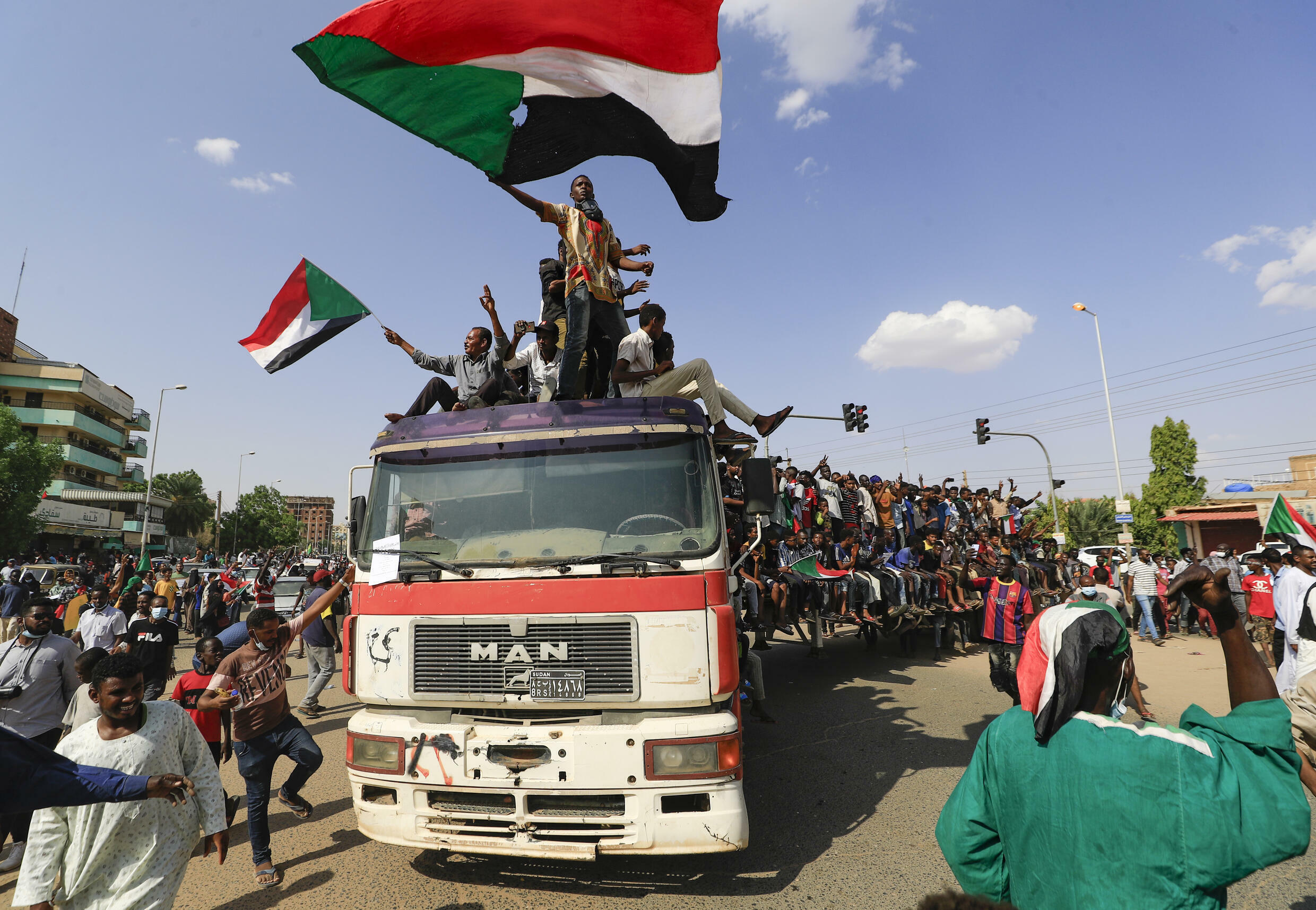 Sudanese demonstrators take to the streets of the capital Khartoum to demand the government's transition to civilian rule