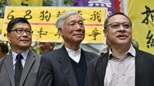 Sociology professor Chan Kin-man (L), baptist minister Chu Yiu-ming (C) and law professor Benny Tai (R) are among the most prominent activists facing sentencing