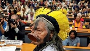 Kayapo ethnic group leader Raoni Metuktire attends a meeting with deputies to discuss the rights of indigenous people at the National Congress in Brasilia, on April 25, 2019