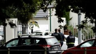 Security officials walk outside the Masjid al Noor mosque in Christchurch after a deadly shooting attack there on March 15, 2019.
