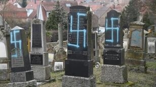 Swastikas were discovered on dozens of graves at the Jewish cemetery in Quatzenheim, eastern France, on Tuesday