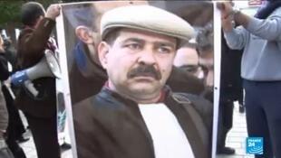 صورة لشكري بلعيد رفعت في أحد المظاهرات.