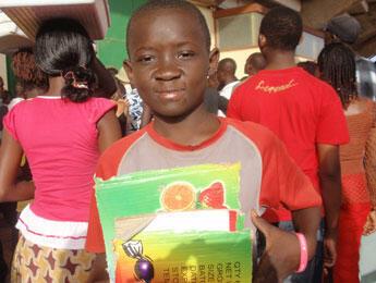 Stephane displays his wares of fruit carton cardboard strips. (Photo: L. Jacinto)
