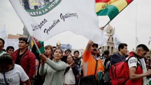Decenas de cultivadores de coca de la región de Los Yungas protestaron para exigir la libertad de Franklin Gutiérrez y en contra del gobierno del presidente Evo Morales, en La Paz, Bolivia , el 19 de marzo de 2019.