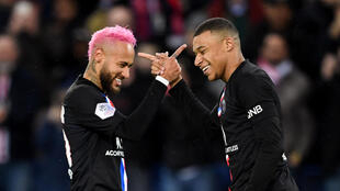 PSG players Neymar (left) and Kylian Mbappe are the two most valuable players in a depressed transfer market, according to KPMG