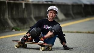 Nongluck Chairuettichai, 63,says taking up the longboard in Bangkok set her on the road to recovery from breast cancer