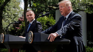 Poland's President Andrzej Duda listens to US President Donald Trump during a joint news conference in the Rose Garden at the White House in Washington, DC on June 24, 2020.