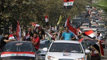 تجمع حاشد لأنصار الأسد في دمشق
