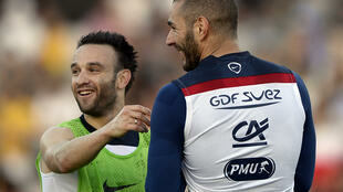Mathieu Valbuena (left) and Karim Benzema (right) during a training session for the national team, in Ribeirao Prato, Brazil, on June 10, 2014.