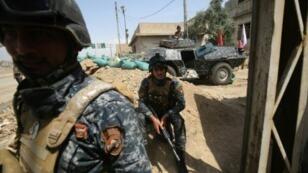 عناصر من القوات العراقية في غرب الموصل في 3 أيار/مايو 2017