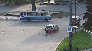 The SBU security service said all 13 hostages were released unharmed after a police stand-off with the man
