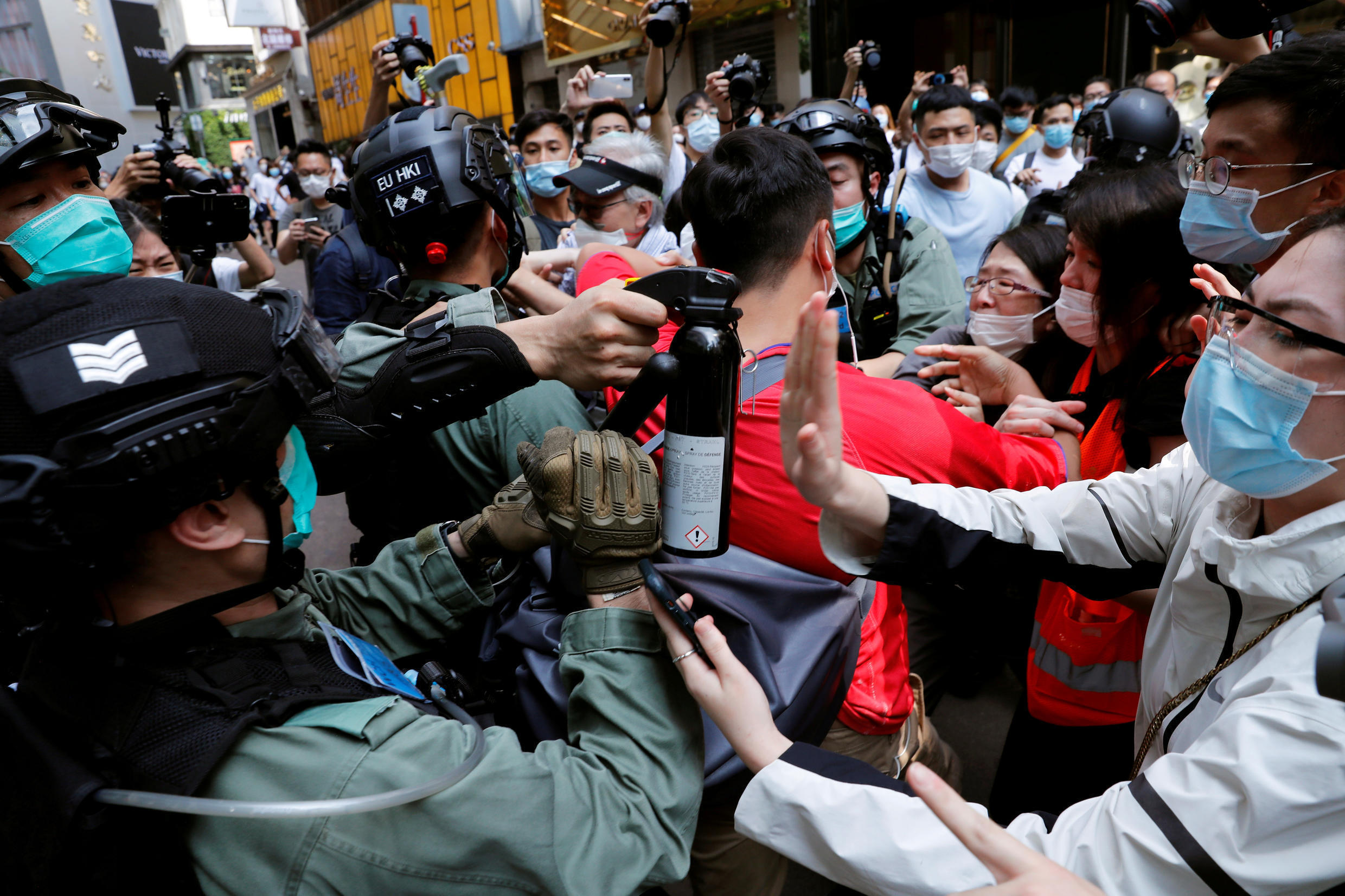 Pro-democracy demonstrators scuffle with riot police during a lunchtime protest as a second reading of a controversial national anthem law takes place in Hong Kong, China on May 27, 2020.