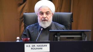 الرئيس الإيراني حسن روحاني يلقي كلمة خلال افتتاح قمة الدول الإسلامية في كوالا لامبور، 19 ديسمبر/كانون الأول 2019.