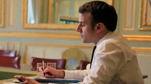 French President Emmanuel Macron attends a videoconference at the Elysee Palace, in Paris, France March 10, 2020.