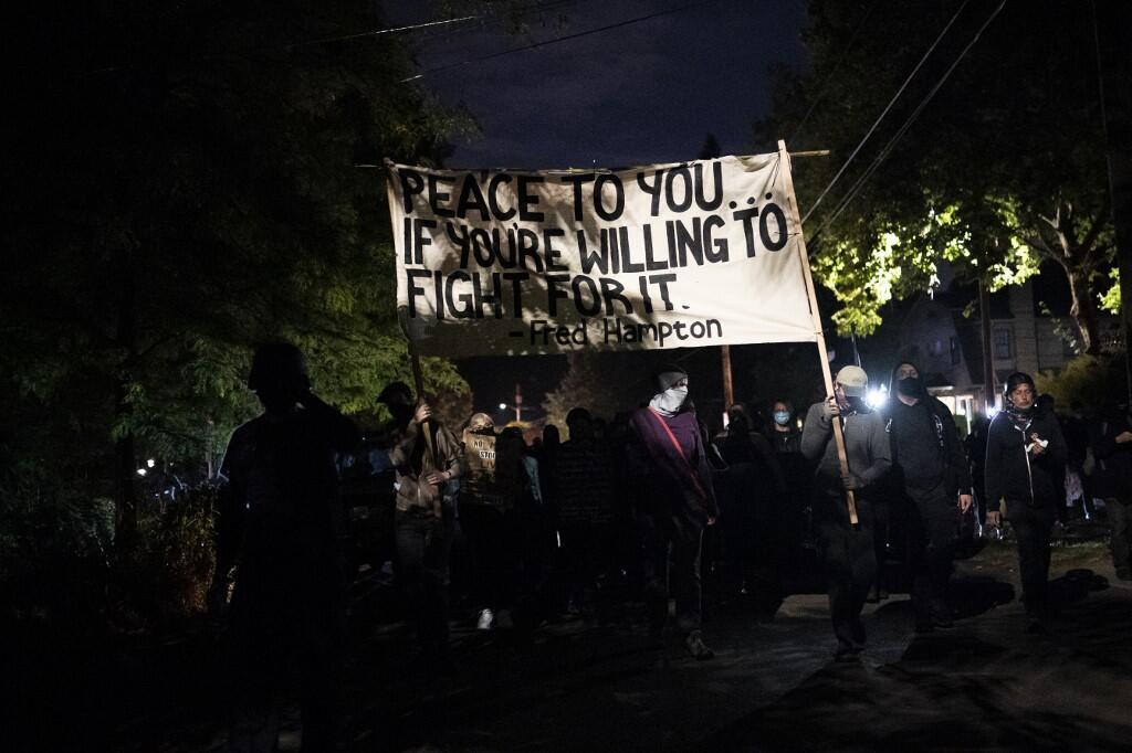 Anti-police protesters march towards the Portland east police precinct a day after political violence left one person dead on August 30, 2020 in Portland, Oregon.