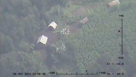 One of few drone-obtained images released by the UN shows a village in eastern Congo in December 2013, shortly after the UN's first drones were deployed in the region.