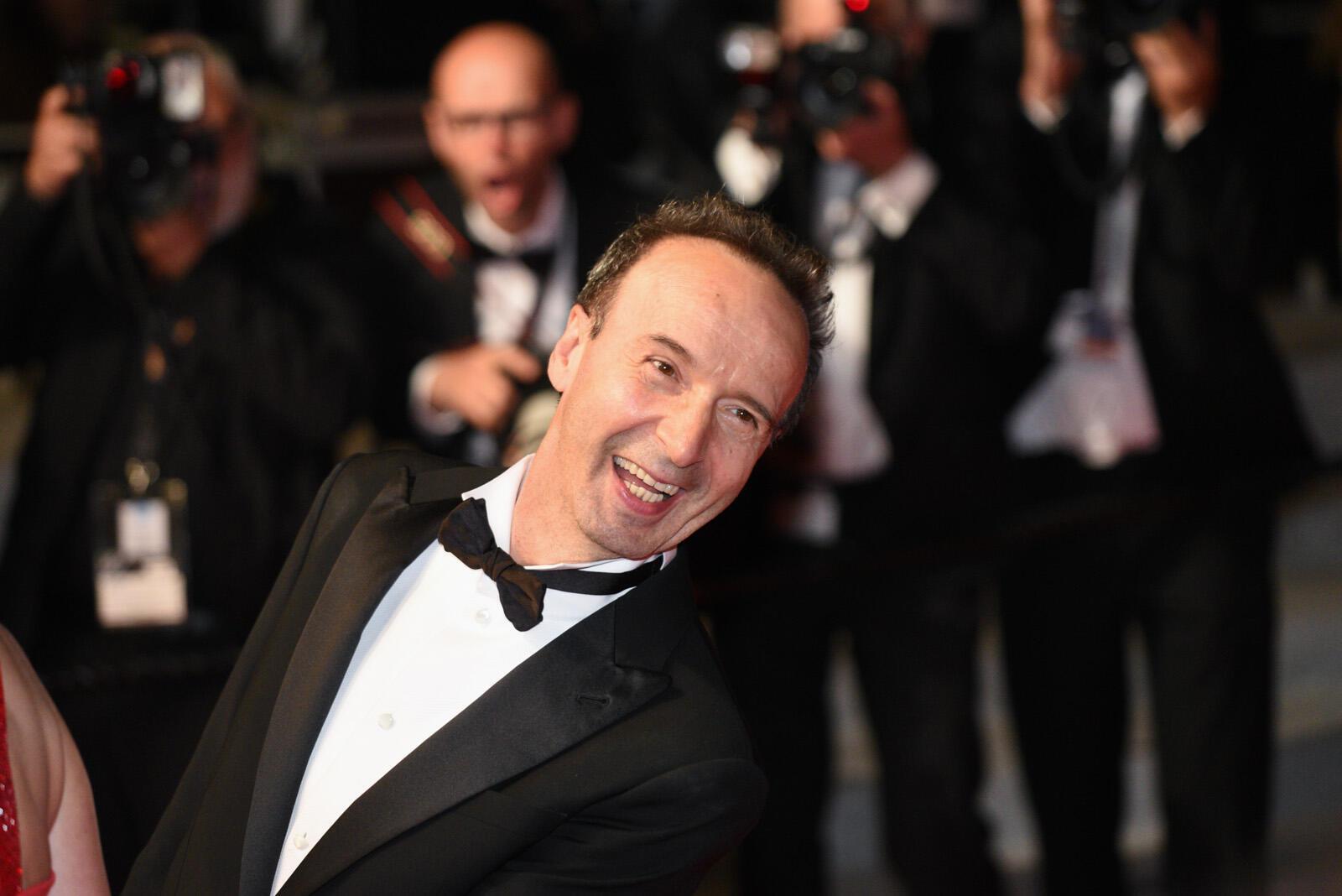 El cineasta italiano Roberto Benigni, muy popular en la Croisette, subió los escalones para asistir al estreno de 'Dogman'. Esta película italiana está en la carrera por la Palma de Oro.
