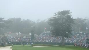Coastal fog clouds the 18th green during a practice round prior to the 2019 US Open Golf Championship at Pebble Beach