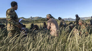 Amhara militia men who combat alongside federal and regional forces against the northern region of Tigray receive training in the outskirts of the village of Addis Zemen, north of Bahir Dar, Ethiopia, on November 10, 2020.