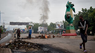 Protesters set barricades to block the Martyrs bridge in Bamako, Mali on July 11, 2020.