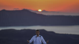 Greek Prime Minister Kyriakos Mitsotakis, seen visiting the island of Santorini, insists the Corfu project is good for the island and also respects the environment