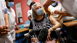 A 78-year-old French woman is vaccinated against Covid-19 at Rene-Muret de Sevran Hospital near Paris, December 27, 2020.