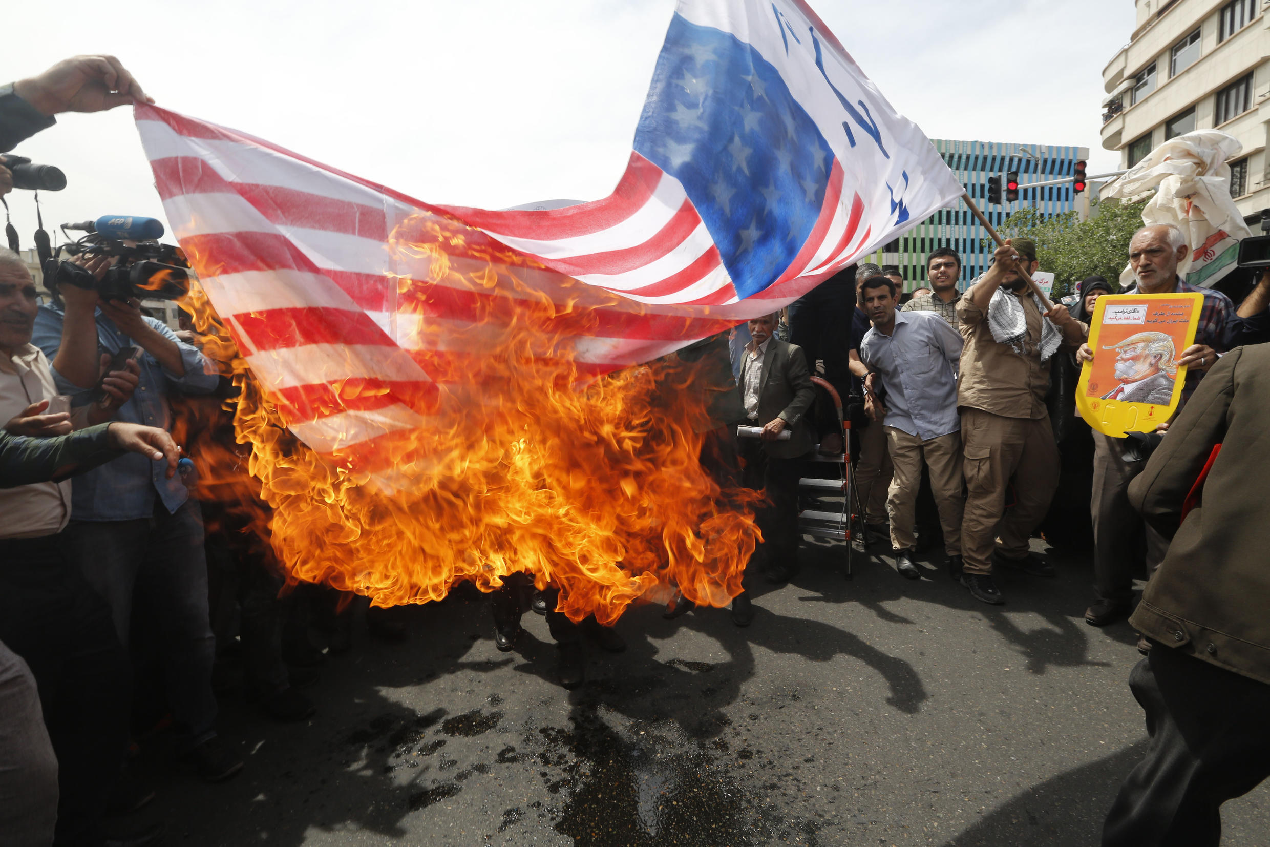 Iranians set an American flag on fire during a demonstration in Tehran on May 11, 2018.
