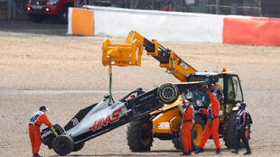The British Grand Prix ran behind the safety car while Kevin Magnussen's crashed Haas was towed away