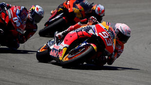 Marc Marquez (R) crashed while running third in Sunday's season-opening MotoGP race in Spain