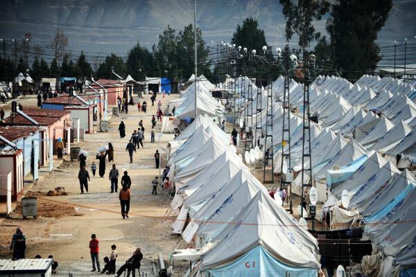Des réfugiés syriens dans le camp de Karkami, près de la ville de Gaziantep, dans le sud de la Turquie, en janvier 2014