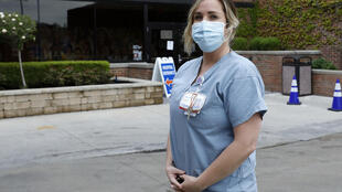 Nurse Nikki Hillis-Walters had two jobs -- one on either side of the US-Canada border