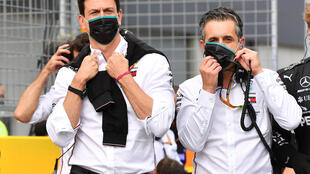 Mercedes team principal Toto Wolff (L) has been angered by his Ferrari counterpart's comments on engine regulations