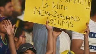 Young solidarity with Christchurch: Pakistani cricket fans hold a placard at the PSL final in Karachi