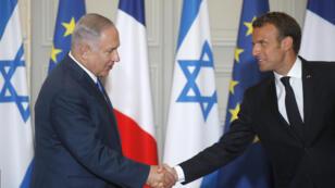 Le chef du gouvernement israélien Benjamin Netanyahou et le président français Emmanuel Macron, lors de la conférence de presse commune à l'Élysée le 5 juin 2018.