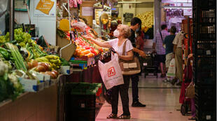 A woman selects fruit and vegetables at a supermarket in Zaragoza, northeastern Spain, on August 10, 2020.