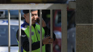 A Malaysian Police officer mans the main gate of the Forensic wing at a hospital in Kuala Lumpur on February 17, 2017, where the body of a man thought to be Kim Jong-Nam, half-brother of a North Korean leader Kim Jong-Un, is being kept.