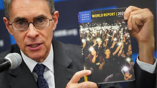 Kenneth Roth, the Executive Director of Human Rights Watch holds up their World Report 2020 at the United Nations in the Manhattan borough of New York City, New York, U.S., January 14, 2020.
